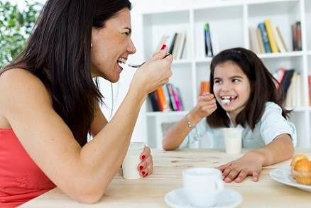 Mother and daughter eating healthy food